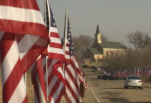 Flags lining the funeral procession route for Lance Cpl. Dale Means to St. Patrick of Cedar Lake Catholic Church.