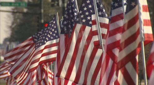 Flags along Main Street in downtown New Prague, Minnesota for the funeral procession of Marine Lance Cpl. Dale Means on November 28, 2012.
