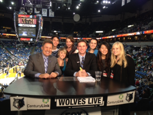 U of M graduate Kelsey Batkiewicz and her classmates with the FSN Timberwolves broadcast team. (Courtesy: Dr. John Eighmey)