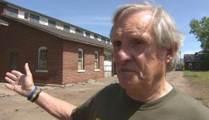 Former homeless veteran Jerry Readmond standing outside the historic Fort Snelling horse stables that will be converted into affordable housing for homeless veterans.  (Photo by Rod Wermager)